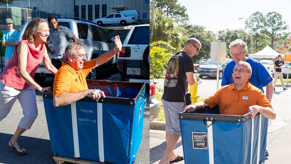 Dave Parrott and Linda Fuchs pushing President Fuchs in a laundry cart.